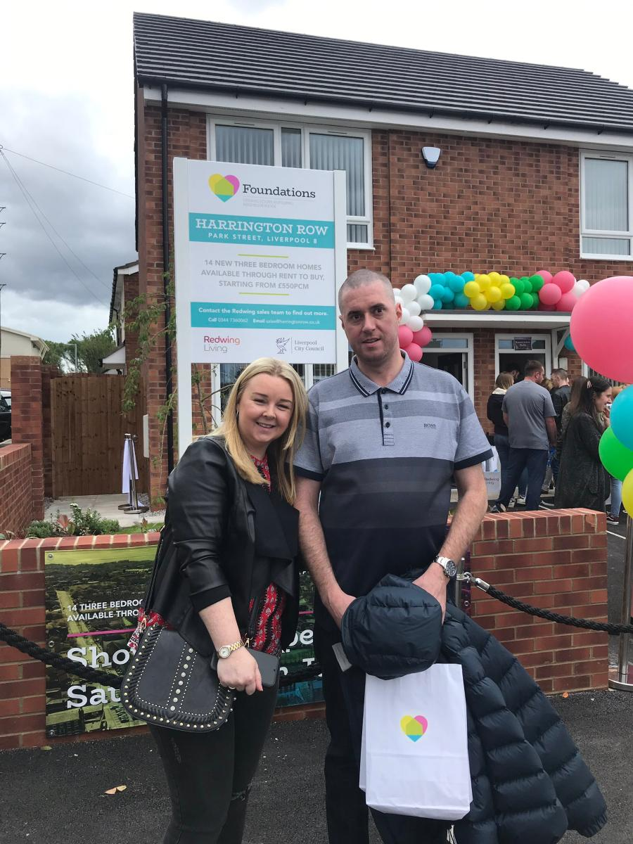 A couple are pleased after reserving a home at Harrington Row